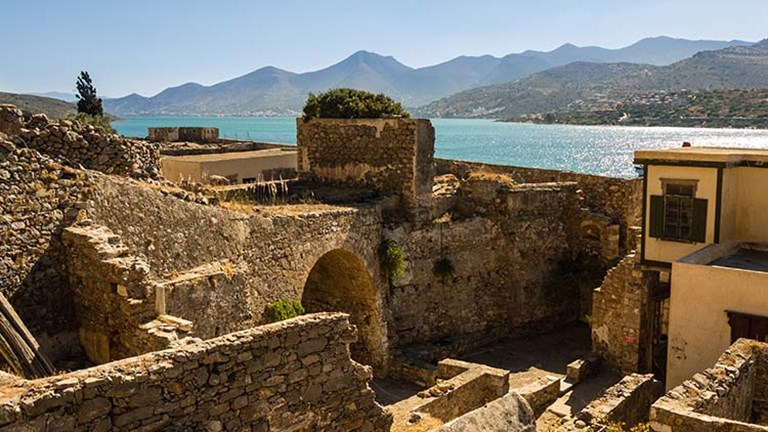 Spinalonga's surrounding views are as captivating as its history and abandoned streets. // © 2017 Creative Commons hatetosketch