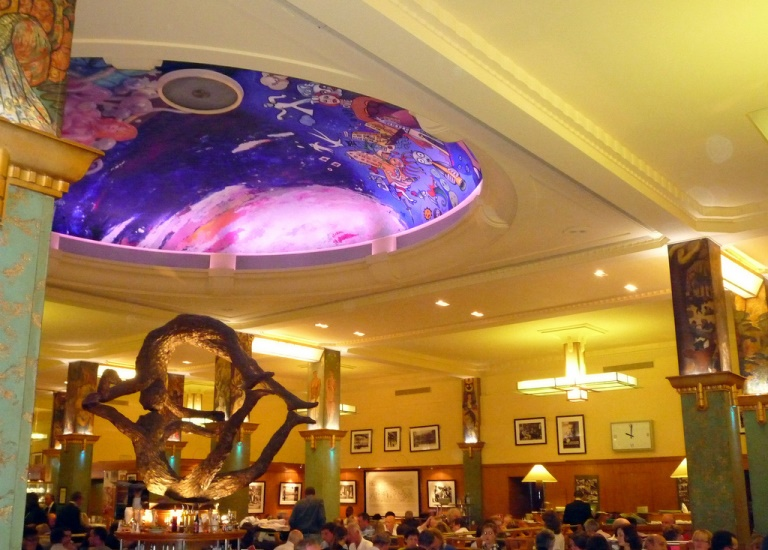"In 2008, four internationally-acclaimed artists — Carole Benzaken, Fouad Bellamine, Xiao-Fan and Ricardo Mosner — adorned the interior dome of La Coupole with the restaurant's original themes: ""woman,"" ""celebration"" and ""nature."" // © 2014 Creative Commons user twiga_269"