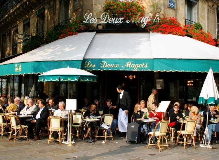 "Les Deux Magots, which means ""two Chinese figurines,"" gets its name from a novelty shop that once occupied its premises before turning into a cafe. // © 2014 Creative Commons user roboppy"