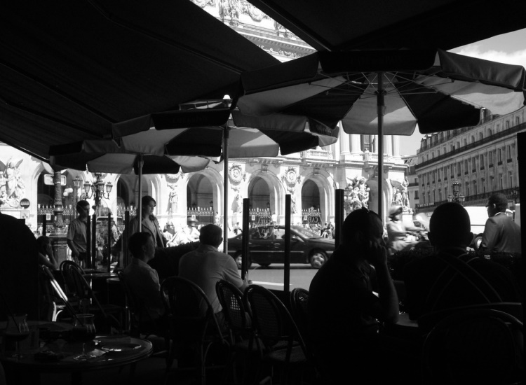 Literary greats such as Oscar Wilde could often be found in the cafes and bars of Paris, including Cafe de la Paix, where patrons also have a view of the famous Palais Garnier opera house. // © 2014 Creative Commons user solapenna