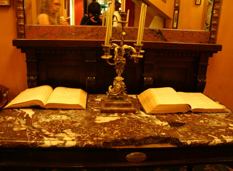 Voltaire's desk is pristinely maintained at Le Procope today. // © 2014 Creative Commons user crustina
