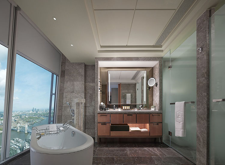 An Iconic City View Room bathroom features heated floors, a bathtub and separate shower and Acqua Di Parma amenities. // © 2017 Shangri-La Hotel, At The Shard, London