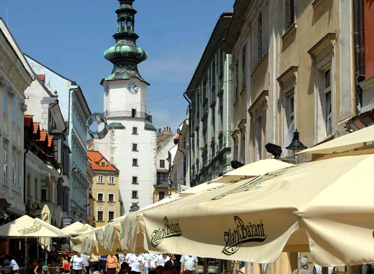 Michael's Gate is an appropriate backdrop to a bustling Bratislava Old Town lane. // © 2014 Courtesy Bratislava Tourist Board