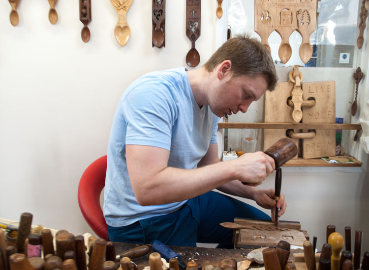 A short drive from Tenby, Wales, is the Lovespoon Workshop, a family-run business that sells hand-crafted lovespoons and teaches about the tradition. // © 2014 Mindy Poder