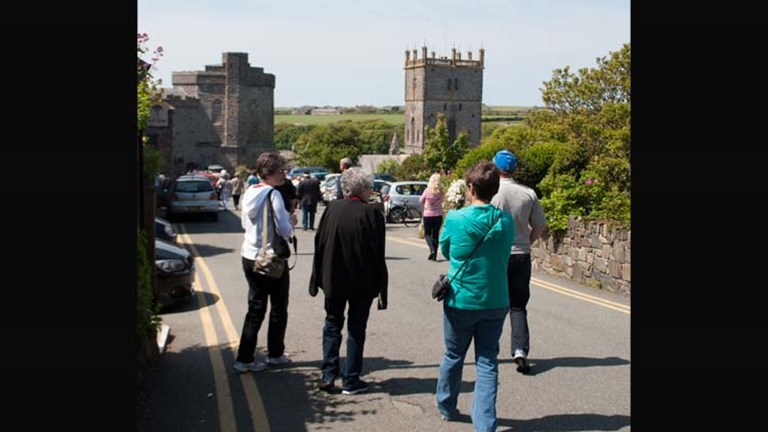 A CIE group approaches the entrance of St. David's Cathedral, which is barely visible from the entrance point. // © 2014 Mindy Poder