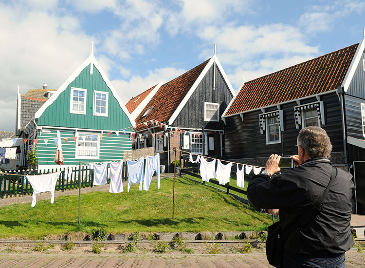 Go beyond Amsterdam to see charming fishing villages and windmill-filled towns that still nostalgically depict Holland's yesteryear. // © 2016 Toms Travel Tours
