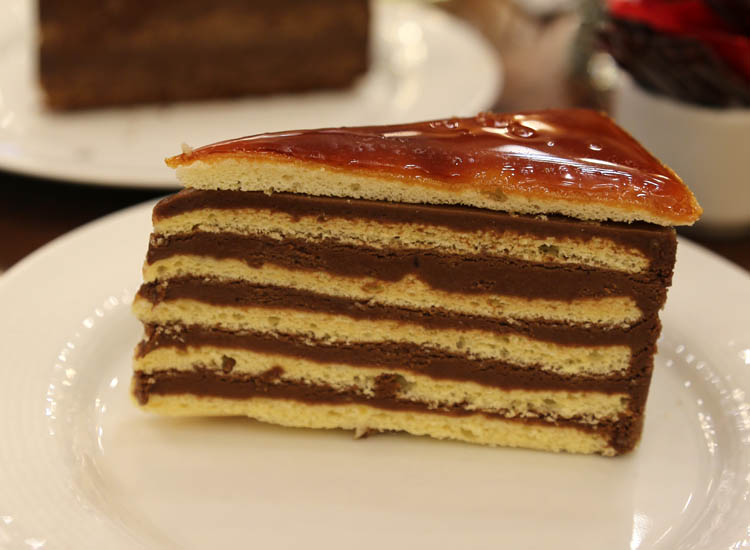Order a dobos torte, a Hungarian sponge cake layered with chocolate buttercream and topped with caramel. // © 2016 Mindy Poder