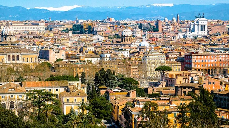 Offering one of Rome's best views, Janiculum Hill faces Rome's historic center, rising just above the idyllic neighborhood of Trastevere (located a half hour away by foot.) // © 2017 iStock