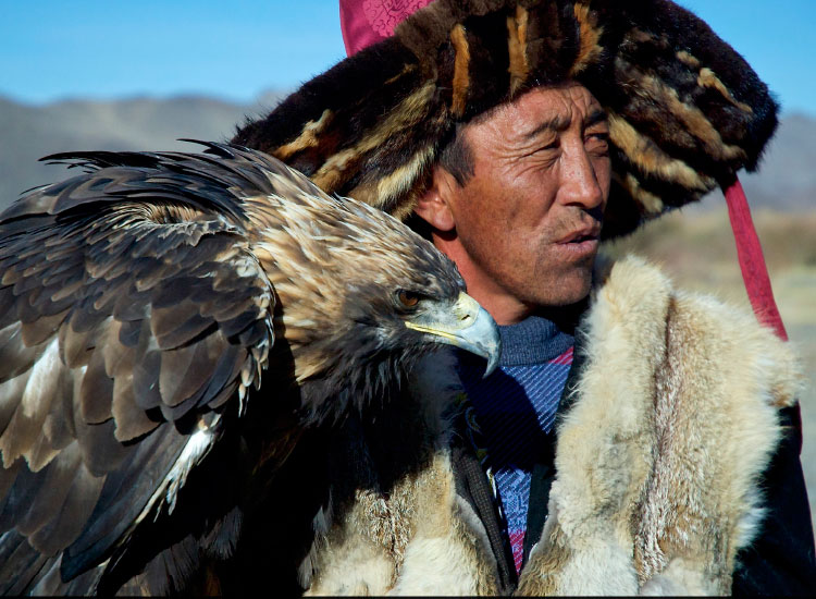 Mongolian man with eagle, Second Place, 2015 TravelAge West reader photo contest // © 2015 Wanda Bogacka-Plucinski