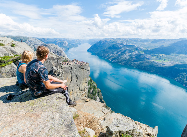 A two-hour hike brings adventurers to the top of Norway's Preikestolen. // © 2016 iStock