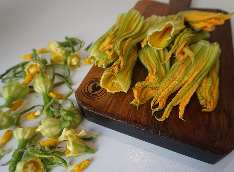 Squash blossoms are prepped before being deep-fried. // © 2017 Valerie Chen