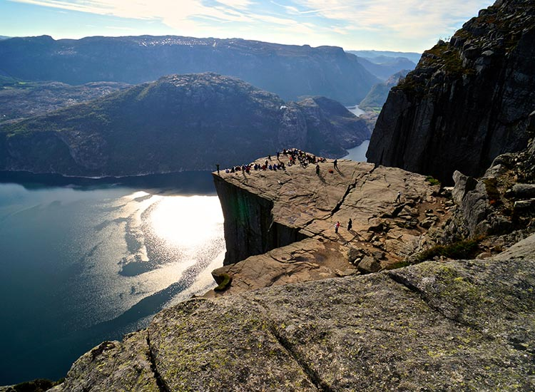 Preikestolen (Pulpit Rock) stands 1,981 feet tall in Norway's south Ryfylke district. // © 2016 Andreas Gruhle/VisitNorway.com