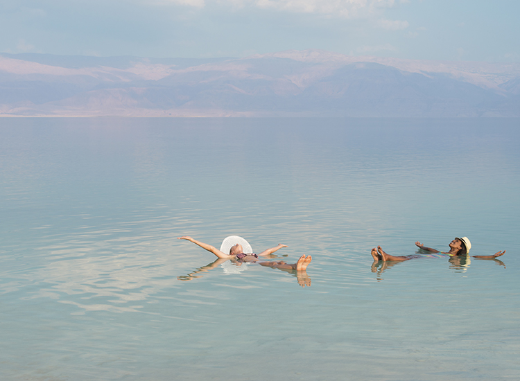 The lake's high salinity enables people to float easily. // © 2015 iStock
