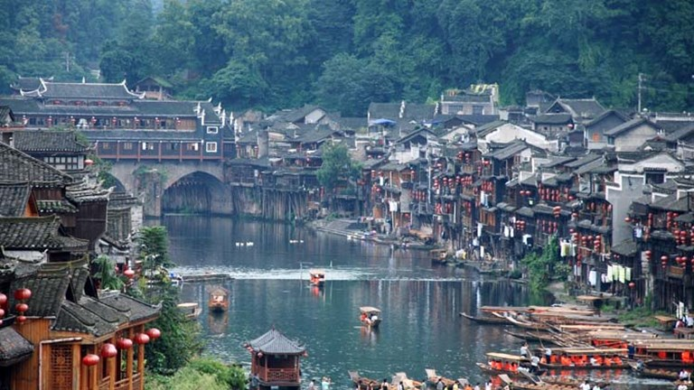 The homes along Fenghuang's canals are raised on stilts. // © 2015 Creative Commons user worldcitizen