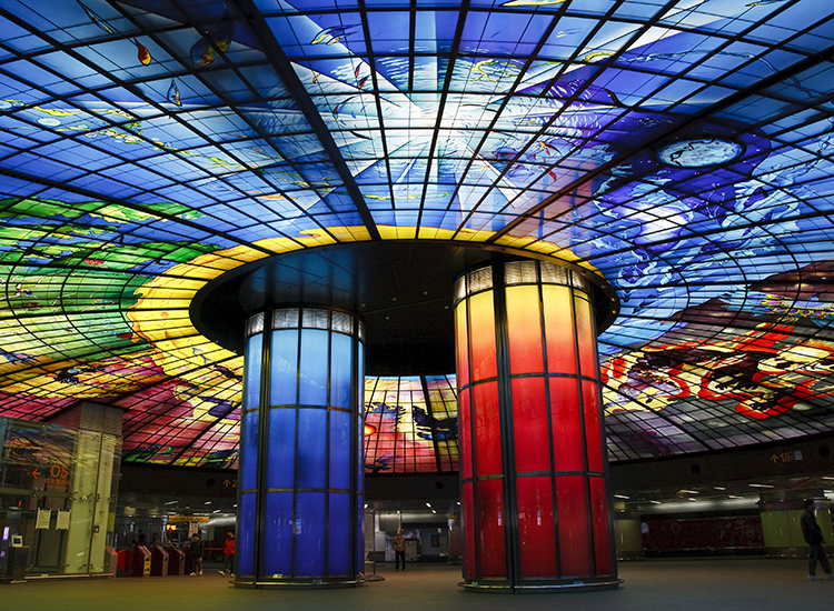 Get hypnotized by the kaleidoscopic dome of light in Taiwan's Formosa Boulevard Station. // © 2014 Creative Commons user kobetsai