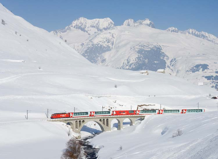 Ride the Glacier Express through the Swiss Alps. // © 2015 Creative Commons user 74331437@N05