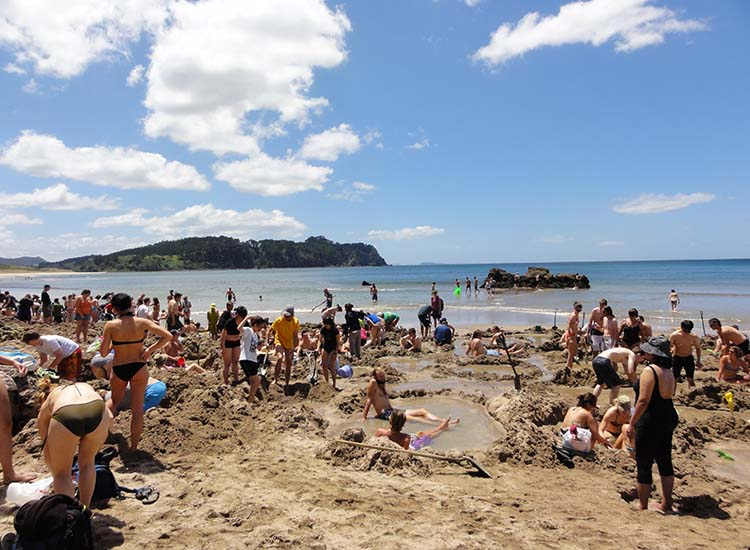 Make sure to pack a shovel to make your own hot spring before heading out to New Zealand's Hot Water Beach. // © 2017 Wikimedia Commons