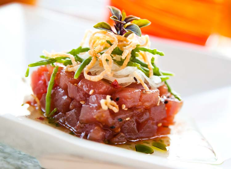 Raw tuna, salmon and octopus are typical poke bases. // © 2014  HTA/Tor Johnson
