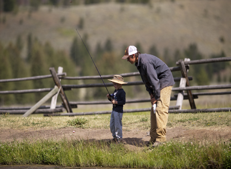 Guests of all ages can try their hand at fly fishing in the property's stocked lake. // © 2015 320 Guest Ranch