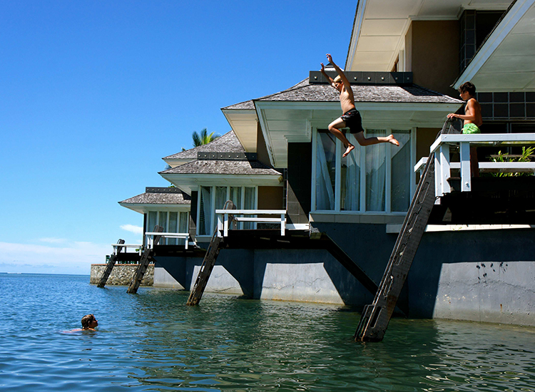 Koro Sun Resort's Edgewater Villas allow children to jump right into the water. // © 2014 Koro Sun Resort