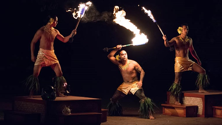 Daring fire knife dancers perform at Ka Waa. // © 2017 Aulani, a Disney Resort & Spa