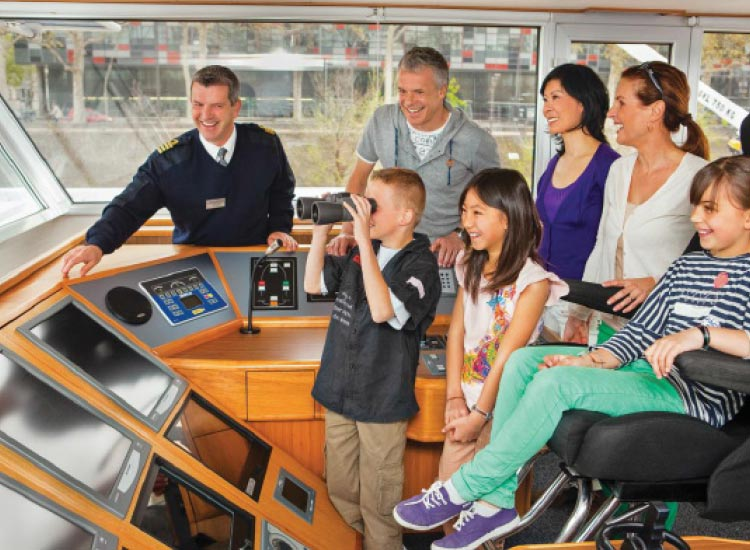 Family-friendly departures by Uniworld Boutique River Cruise Collection might include a visit to the captain's seat. // © 2015 Uniworld Boutique River Cruise Collection