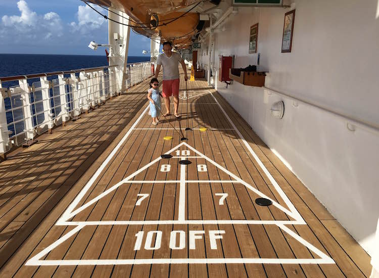 A family game of shuffleboard on Deck 4 is a fun way to enjoy the ocean breeze and views. // © 2016 Chelsee Lowe