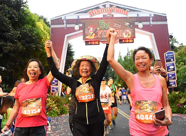 Anaheim, Calif., runner Ellen Lem — who, at 90 years old, is one of the oldest runners to ever participate in a Disneyland Half Marathon Weekend — ran the 5K along with her two daughters. // © 2017 Disneyland Resort