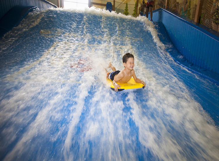Try your hand at boogie boarding on simulator Wolf Rider Wipeout. // © 2016 Great Wolf Lodge
