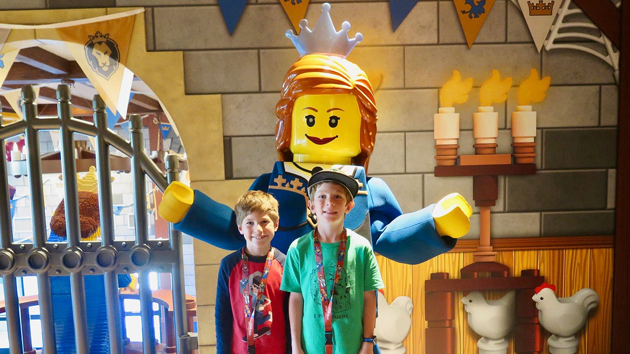 Asher and Elijah Smith pose with a Lego statue of Princess Brickney.