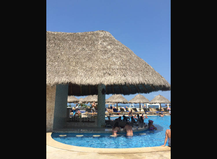 When parents staying at Iberostar Playa Mita can escape for a moment, they should swim up to this beautiful bar at the main pool. // © 2015 Chelsee Lowe