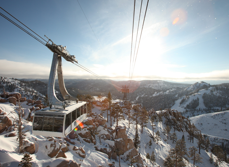 Squaw's scenic aerial tram brings guests to the eateries and sights of High Camp at 8,200 feet. // © 2015 Trevor Clark