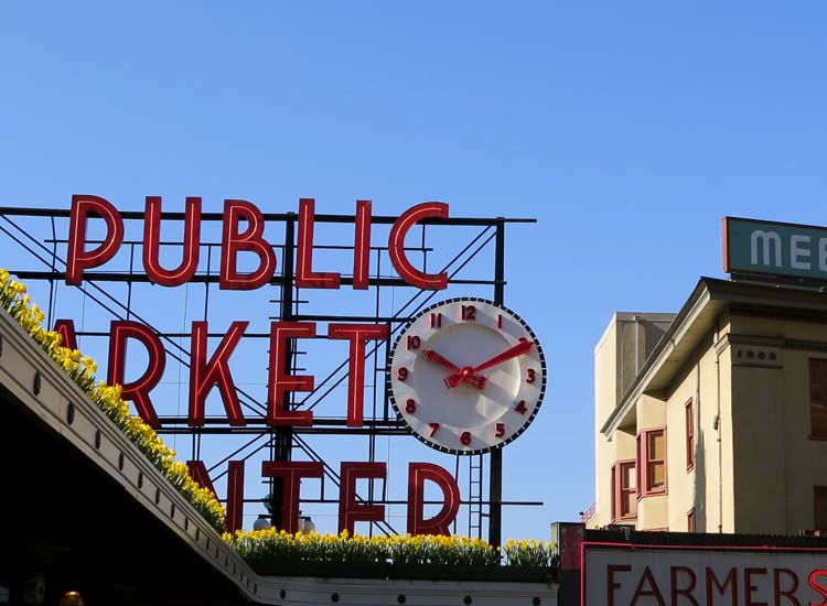 Don't miss Pike Place Market, home to fish slingers, cheese shops and the first Starbucks location. // © 2015 Samantha Davis Friedman