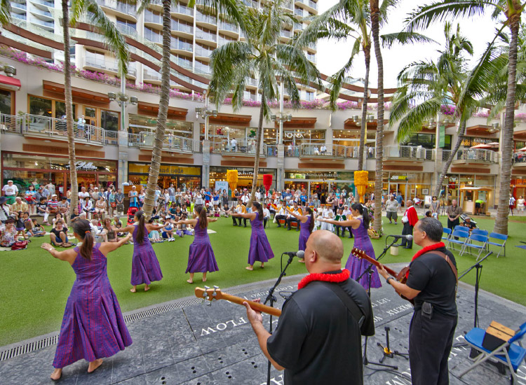 Visitors and locals enjoy live island performances at Waikiki Beach Walk, a symbol of Outrigger's dedication to the destination and its culture. // © 2017 Outrigger Hotels and Resorts