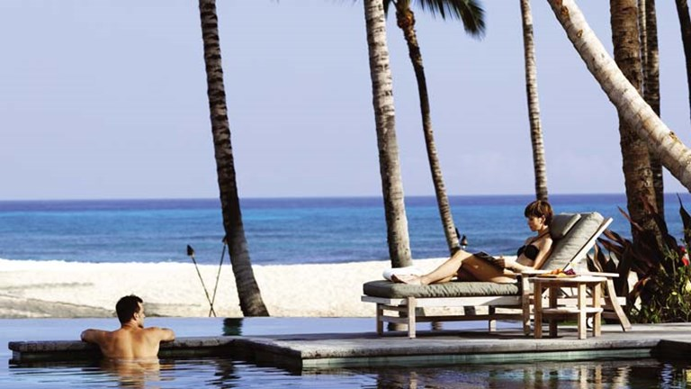 This exclusive Hawaii Island pool spoils guests with ocean views. // © 2014 Four Seasons Resort Hualalai