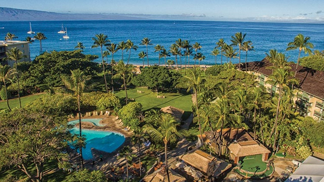 Guests can take a dip in the on-site whale-shaped pool or stroll the tropical gardens. // © 2018 Kaanapali Beach Hotel