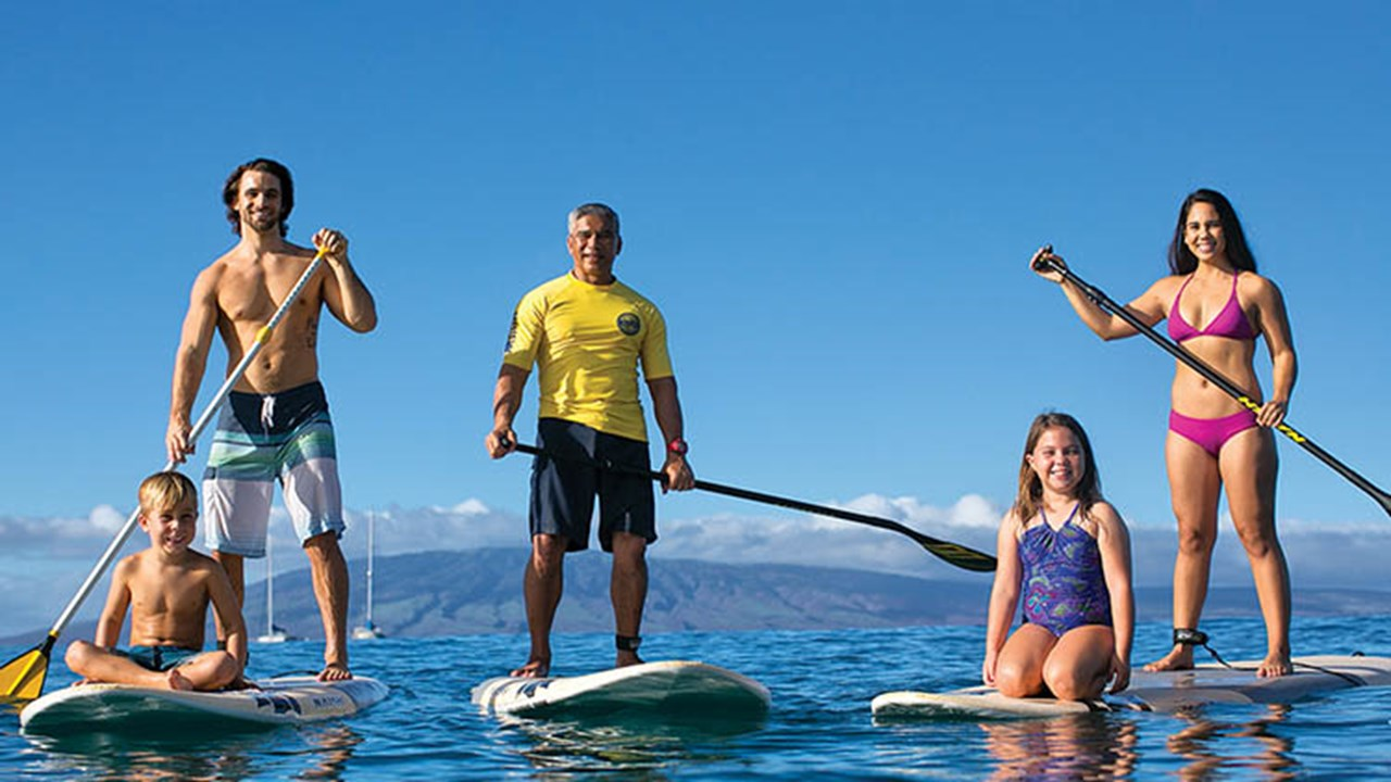 Paddleboarding lessons are available via the KBH's water activities center, Hale Huakai. // © 2018 Kaanapali Beach Hotel