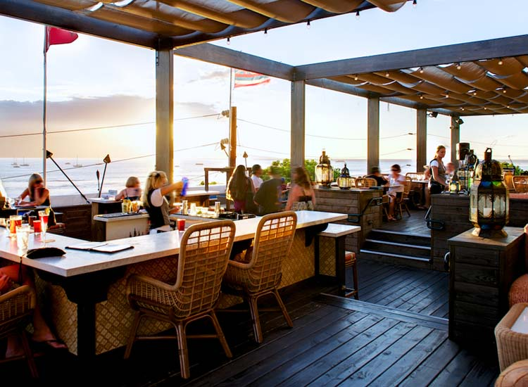 The dining deck at Fleetwood's on Front Street is a beautiful setting for a sunset dinner. // © 2014 Fleetwood's on Front Street