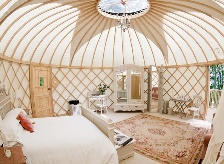 Yurts at Priory Bay Hotel in England include stable doors with French windows, a king-size bed, an en suite bathroom and a secluded terrace, as well as access to the property's activities (a falconry course, for example). // © 2015 Priory Bay Hotel