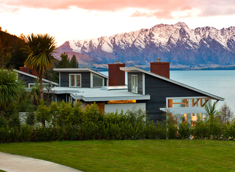 The lodge, located on scenic Lake Wakatipu, offers just 12 guestrooms and suites, each with its own private porch and open fireplace. // © 2017 Matakauri Lodge
