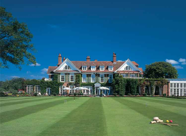 Sitting on 130 acres of countryside in Hampshire, Chewton Glen comprises a main hotel and 12 special Treehouse units. // © 2014 Chewton Glen