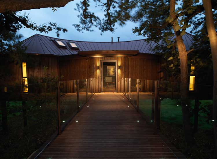 The Treehouses at Chewton Glen are separate from the rest of the property and include special amenities exclusive to Treehouse guests. // © 2014 Chewton Glen