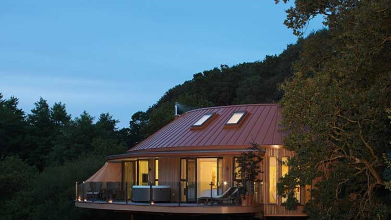 The Treehouse suites are lifted up on stilts to provide stunning views above the treeline. // © 2014 Chewton Glen