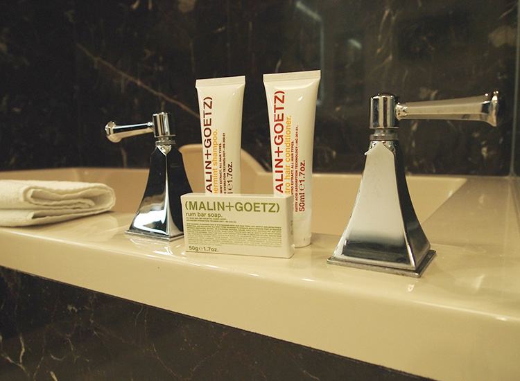 Malin + Goetz toiletries, along with super soft white robes and slippers, bring a touch of powder-room luxury to Delano Las Vegas. // © 2014 Robin Rockey