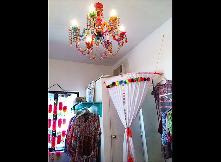 Ula is a shop decorated in poms and color, featuring scarves, handbags, bikinis and more. // © 2015 GypsetGirl.com