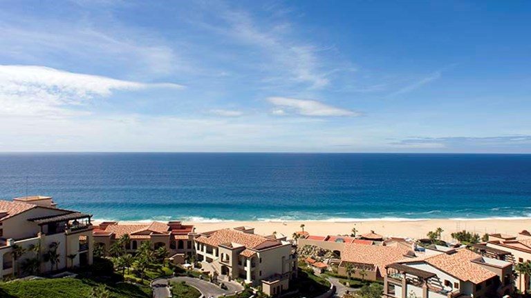 The all-inclusive Pueblo Bonito Sunset Beach Golf & Spa Resort in Los Cabos has yoga classes on the balcony of the property's oceanfront fitness center. // © 2016 Pueblo Bonito Sunset Beach Golf & Spa Resort