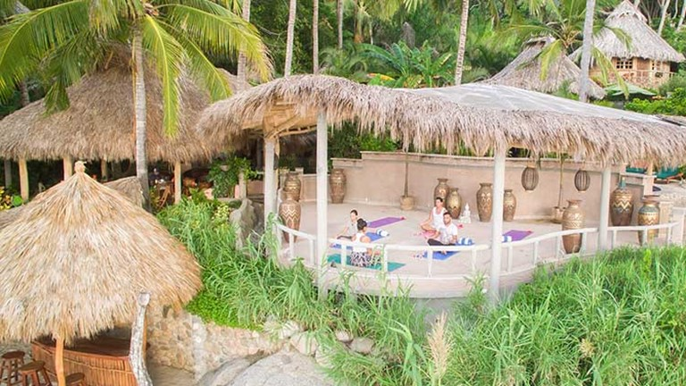 "Sayulita's Playa Escondida has a new, thatch-roofed ""palapa"" hut, designed specifically for yoga. // © 2016 Mexico Boutique Hotels"