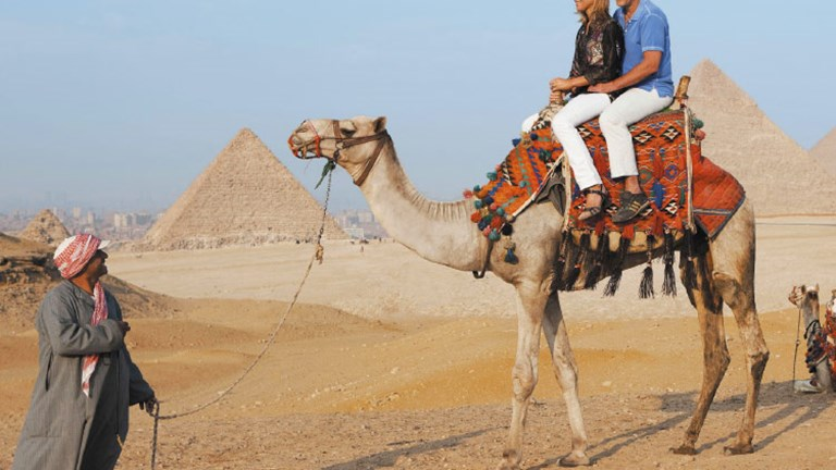 One draw of river cruising to an exotic destination is the choice of land excursions, such as riding camels in Egypt. // © 2015 Uniworld Boutique River Cruise Collection
