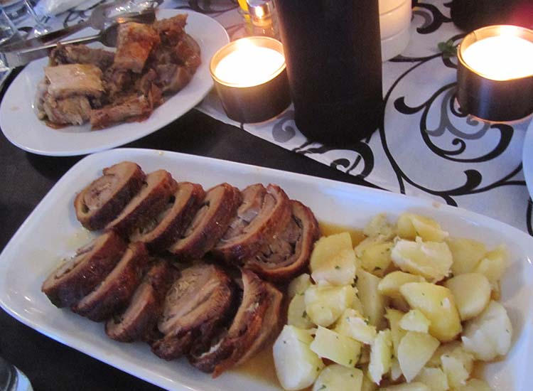Traditional Serbian fare, such as roasted pork and potatoes, was served at the event. // © 2016 Elizabeth Dupuis
