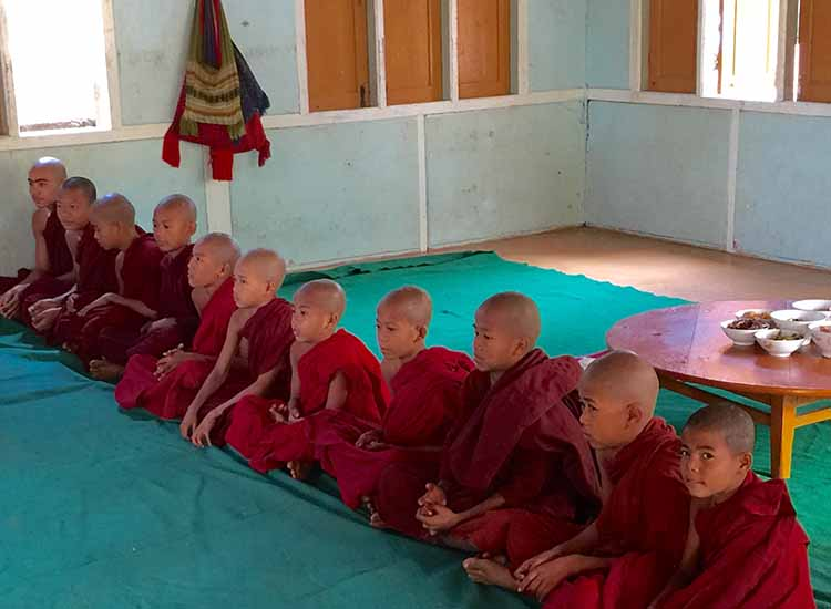Young monks in training greet our group. // © 2016 Kenneth Shapiro